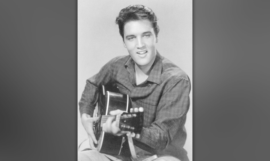 Elvis Presley, American singer and actor, 1950s. Elvis (1935-1977) playing the guitar. (Photo by Ann Ronan Pictures/Print Col