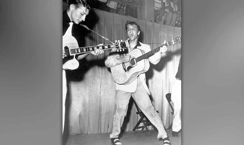 TAMPA, FL - JULY 31: Rock and roll singer Elvis Presley performs on stage with his brand new Martin D-28 acoustic guitar on J