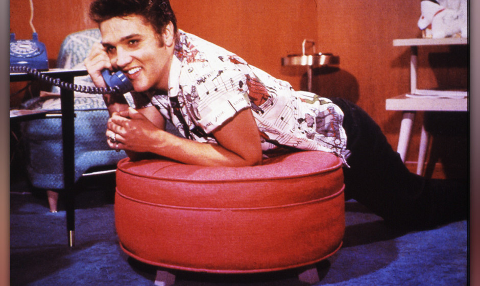 UNSPECIFIED - JANUARY 01:  (AUSTRALIA OUT) Photo of Elvis PRESLEY; posed, on phone  (Photo by GAB Archive/Redferns)
