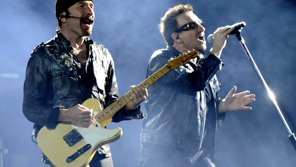 OAKLAND, CA - JUNE 7: The Edge (L) and Bono of U2 perform in support of the bands' U2 360 Tour at Overstock.com Coliseum on J