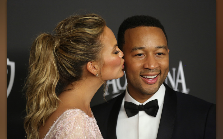 Chrissy Teigen, left, and John Legend arrive at the 16th annual InStyle and Warner Bros. Golden Globes afterparty at the Beve