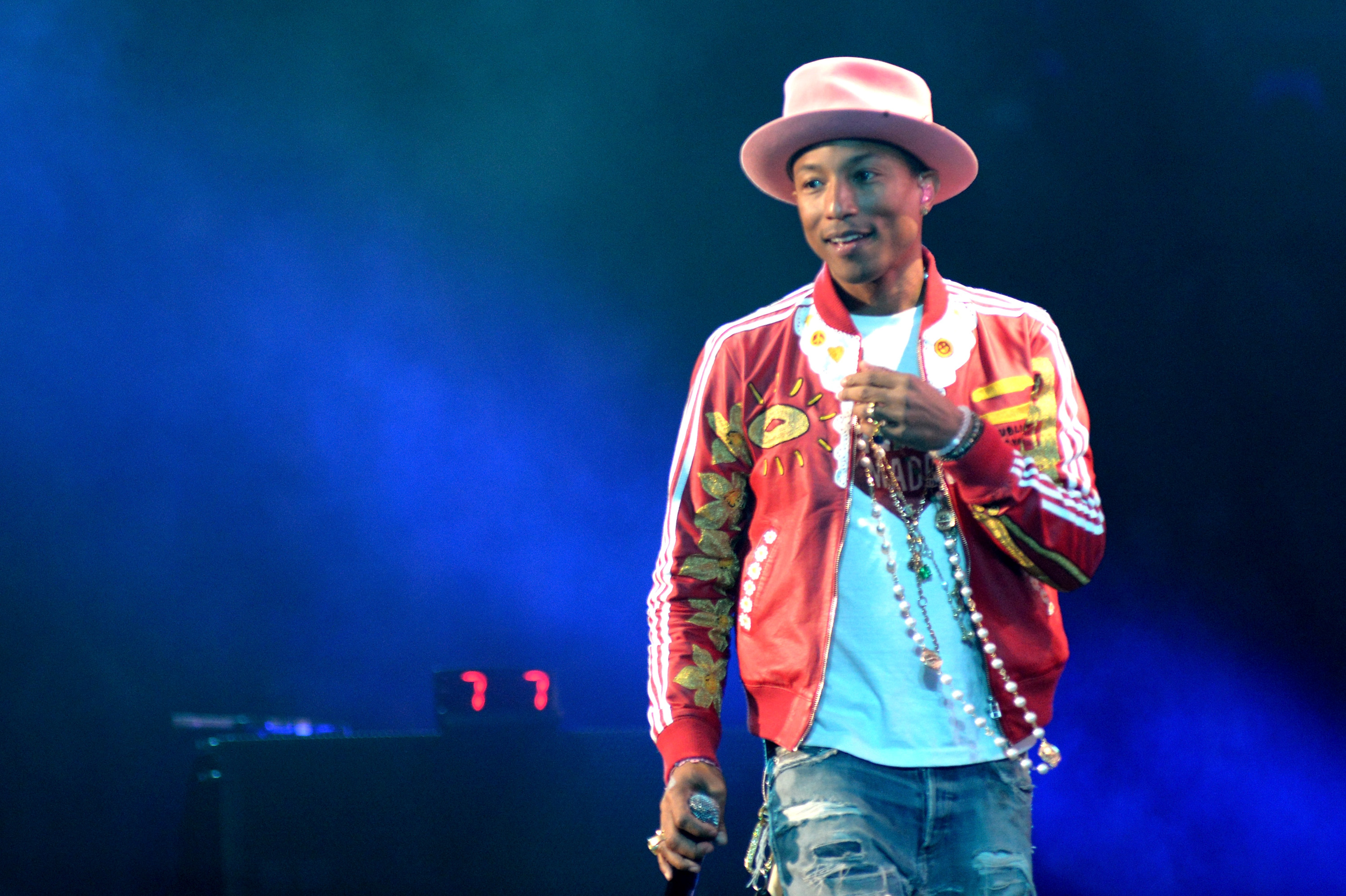 TAMPA, FL - DECEMBER 22:  Pharrell Williams performs onstage during 93.3 FLZ's Jingle Ball 2014 at Amalie Arena on December
