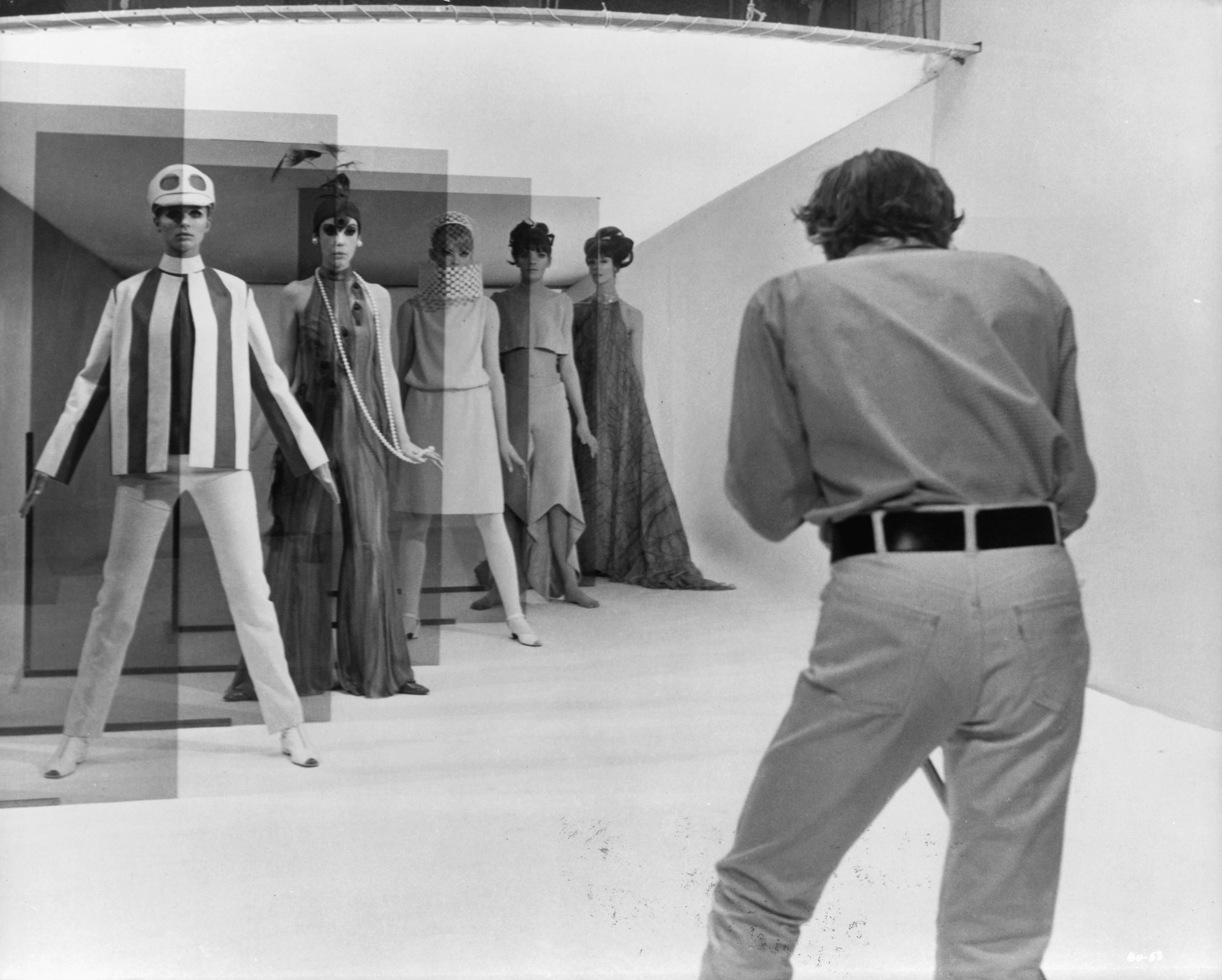 David Hemmings shoots a high fashion session with five models, Jill Kennington, Peggy Moffit, Rosaleen Murray, Ann Norman and