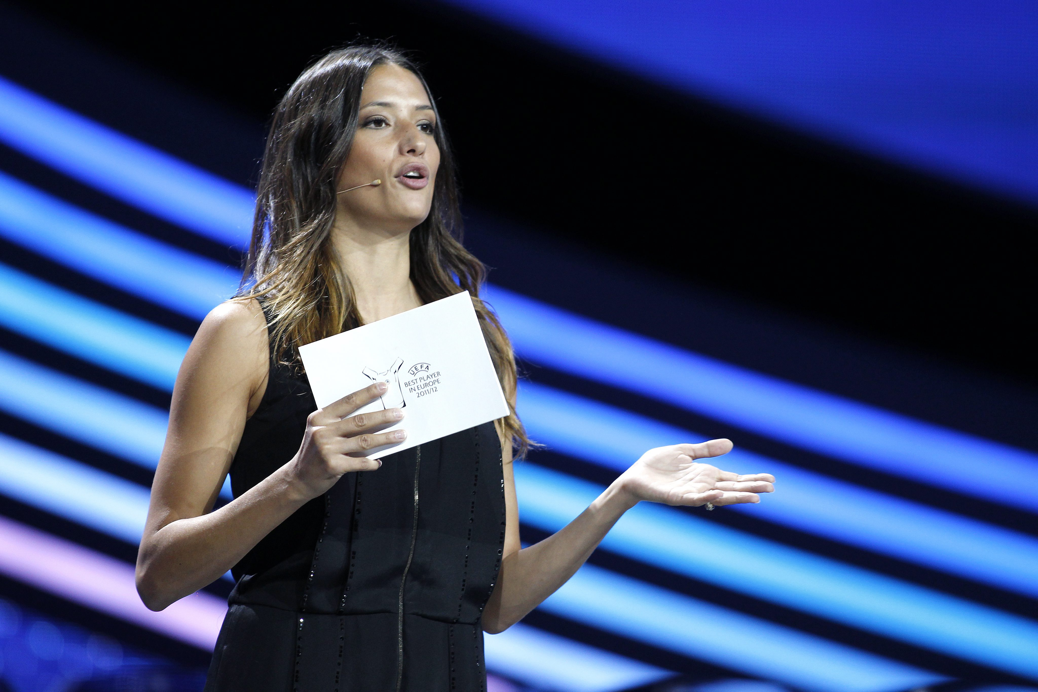 epa03375639 Swiss actress Melanie Winiger hosts the draw ceremony for the UEFA Champions League group stage at Grimaldi Forum