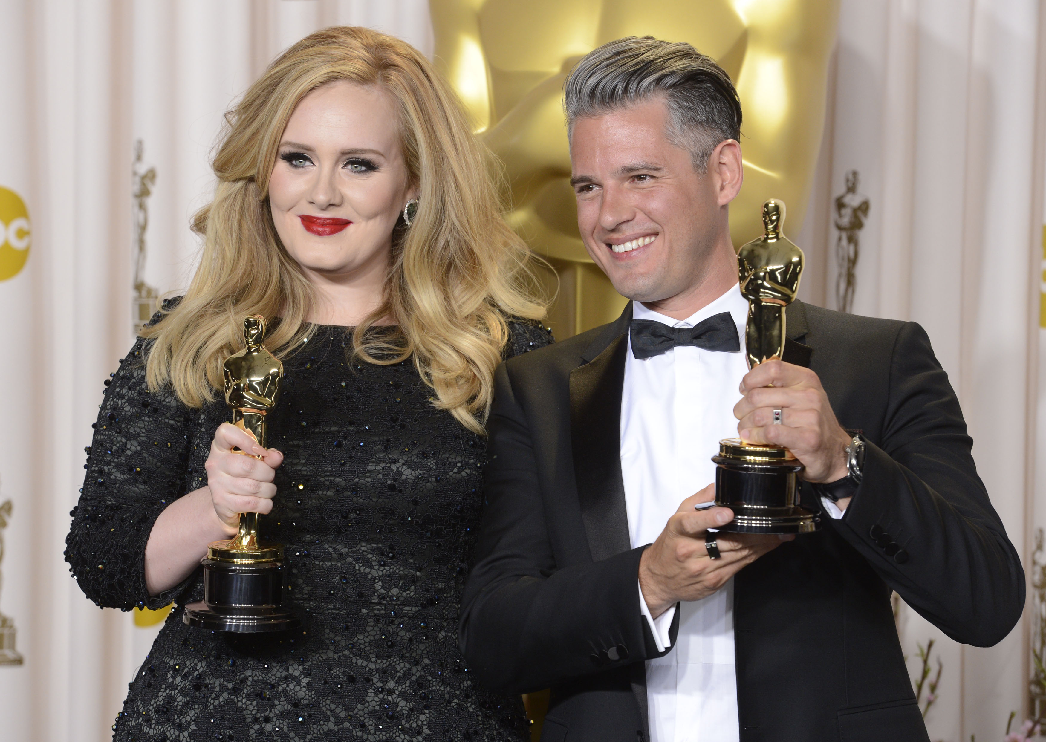 Image #: 21361139    OSCARS – PRESSROOM – Adele Adkins and Paul Eqworth pose with their Oscars for Achievement in Music (Or