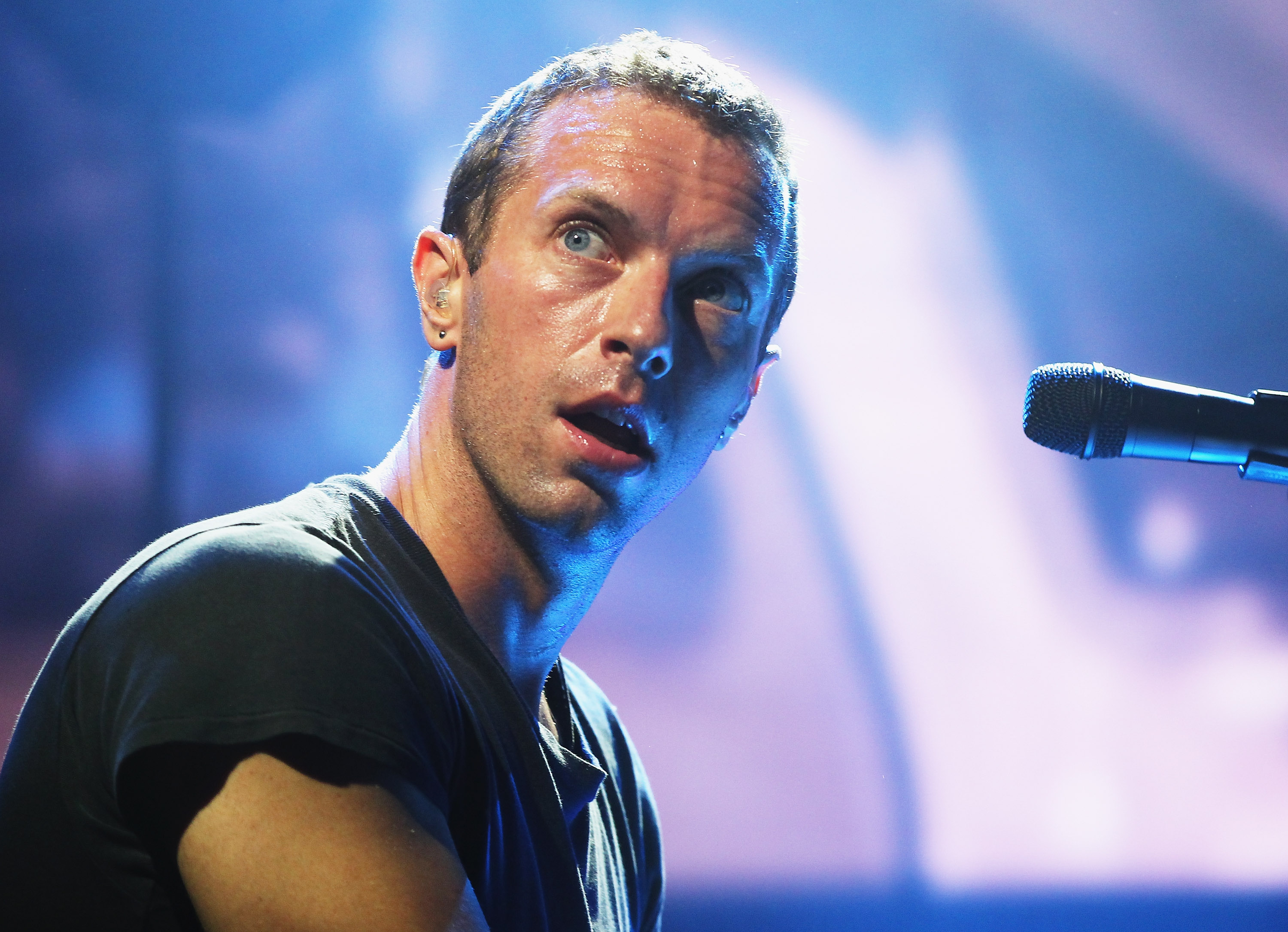 SYDNEY, AUSTRALIA - JUNE 19:  Chris Martin of Coldplay performs live for fans at Enmore Theatre on June 19, 2014 in Sydney, A