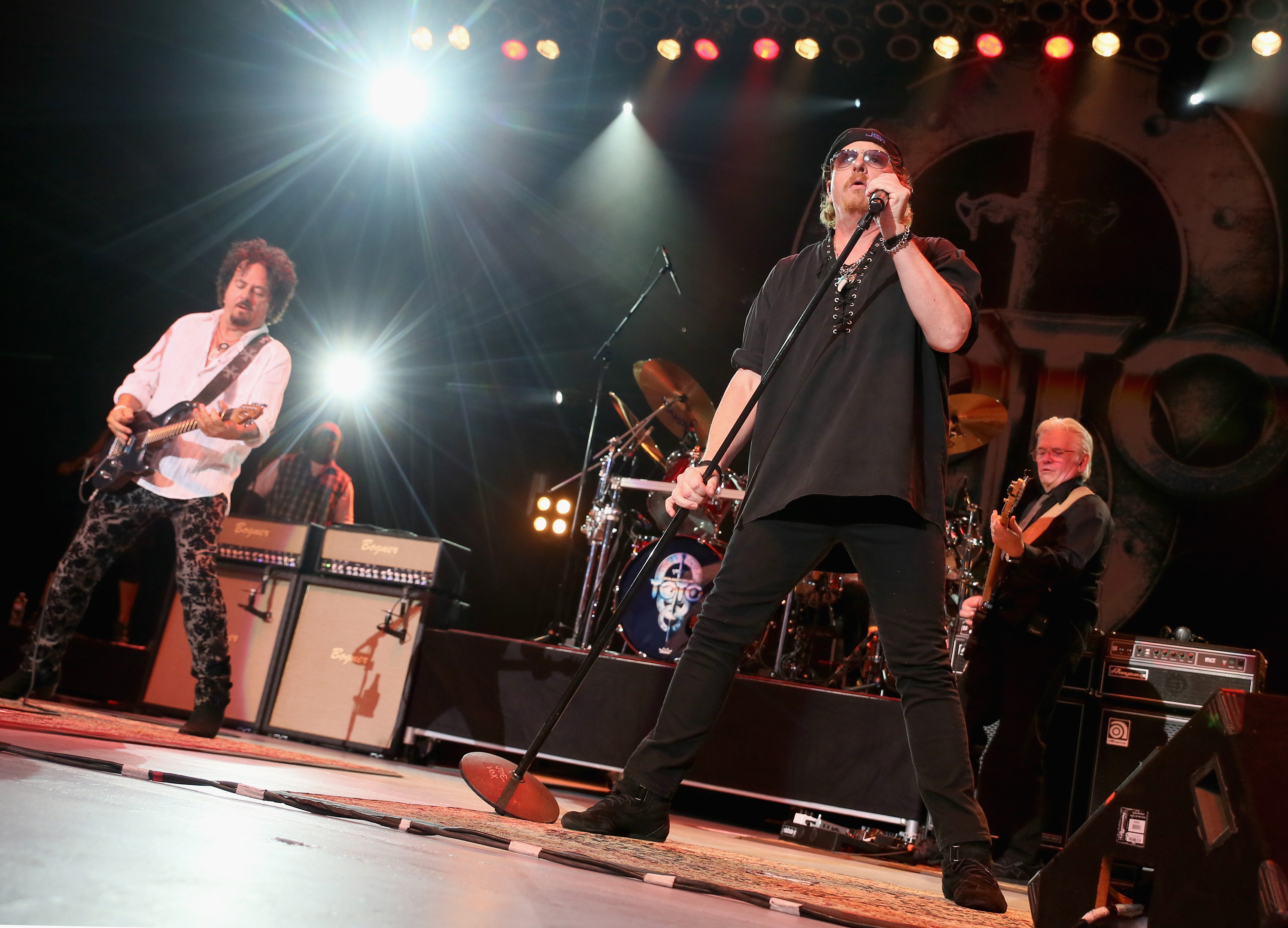 LOS ANGELES, CA - AUGUST 07: (L-R) Steve Lukather, Joseph Williams and David Hungate of Toto perform at The Greek Theatre on