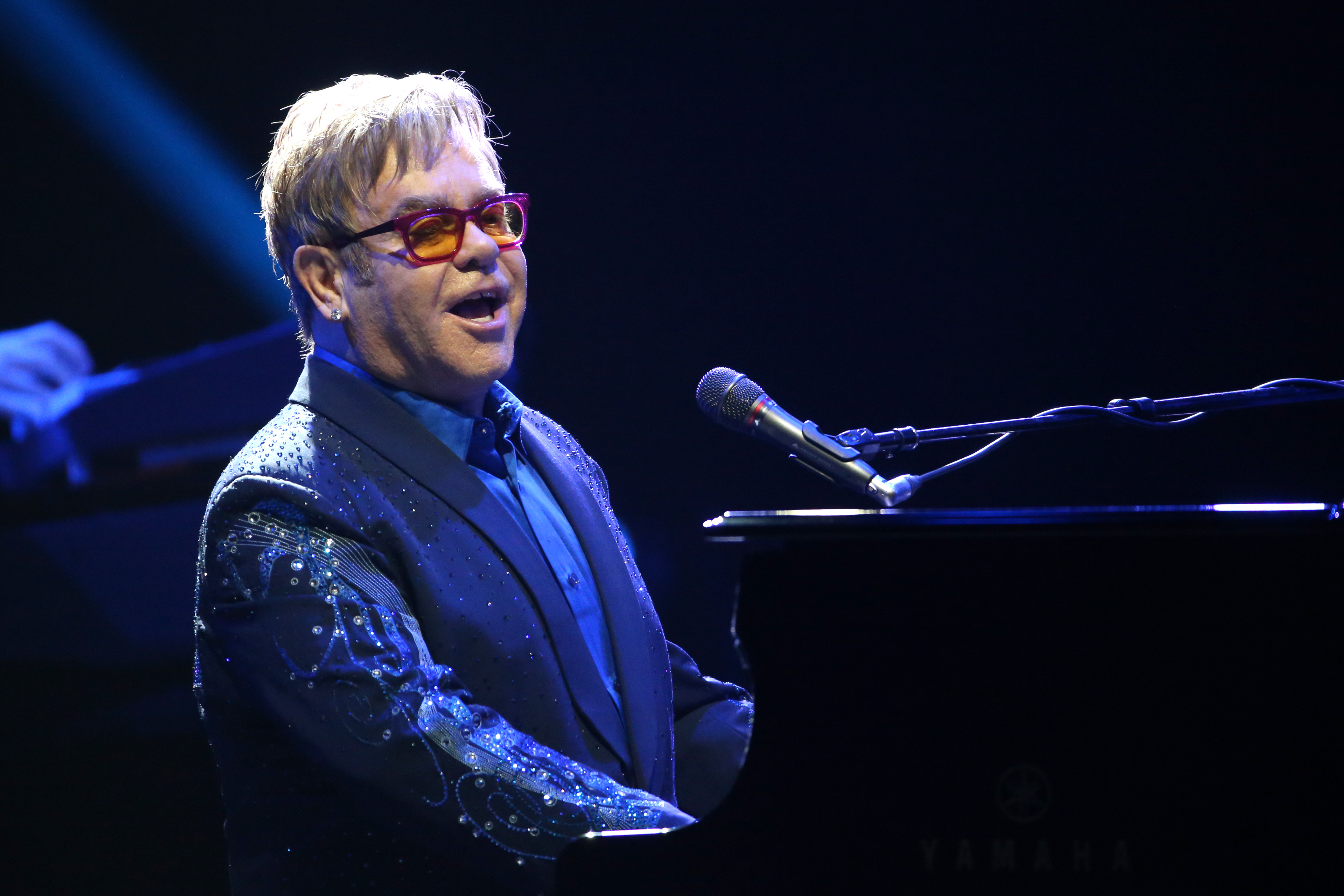 British singer Elton John performs during a concert at the Olympia concert hall in Paris on December 10, 2013.       AFP PHOT
