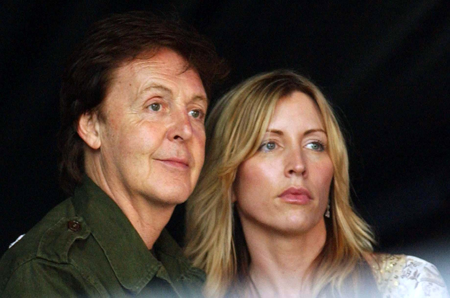 Paul McCartney and Heather Mills McCartney watch Keane performing on stage at the Live 8 concert in Hyde Park, London, Saturd