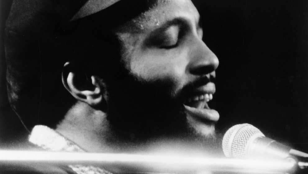CIRCA 1976: Singer and composer Andrae Crouch plays the piano as he sings in to a microphone in circa 1976. (Photo by Michael