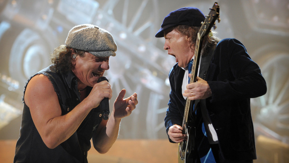 British singer Brian Johnson (L) and guitarist Angus Young of the hard rock band AC/DC perform at the Palais Omnisport of Par