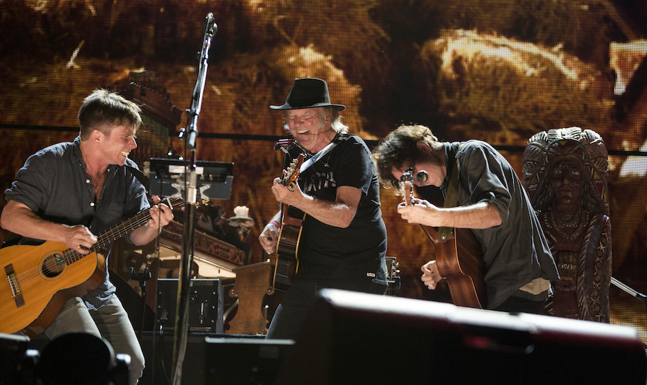 (L to R) Lukas Nelson, Neil Young and Micah Nelson performing at the 2014 Farm Aid concert on September 13, 2014 at Walnut Cr
