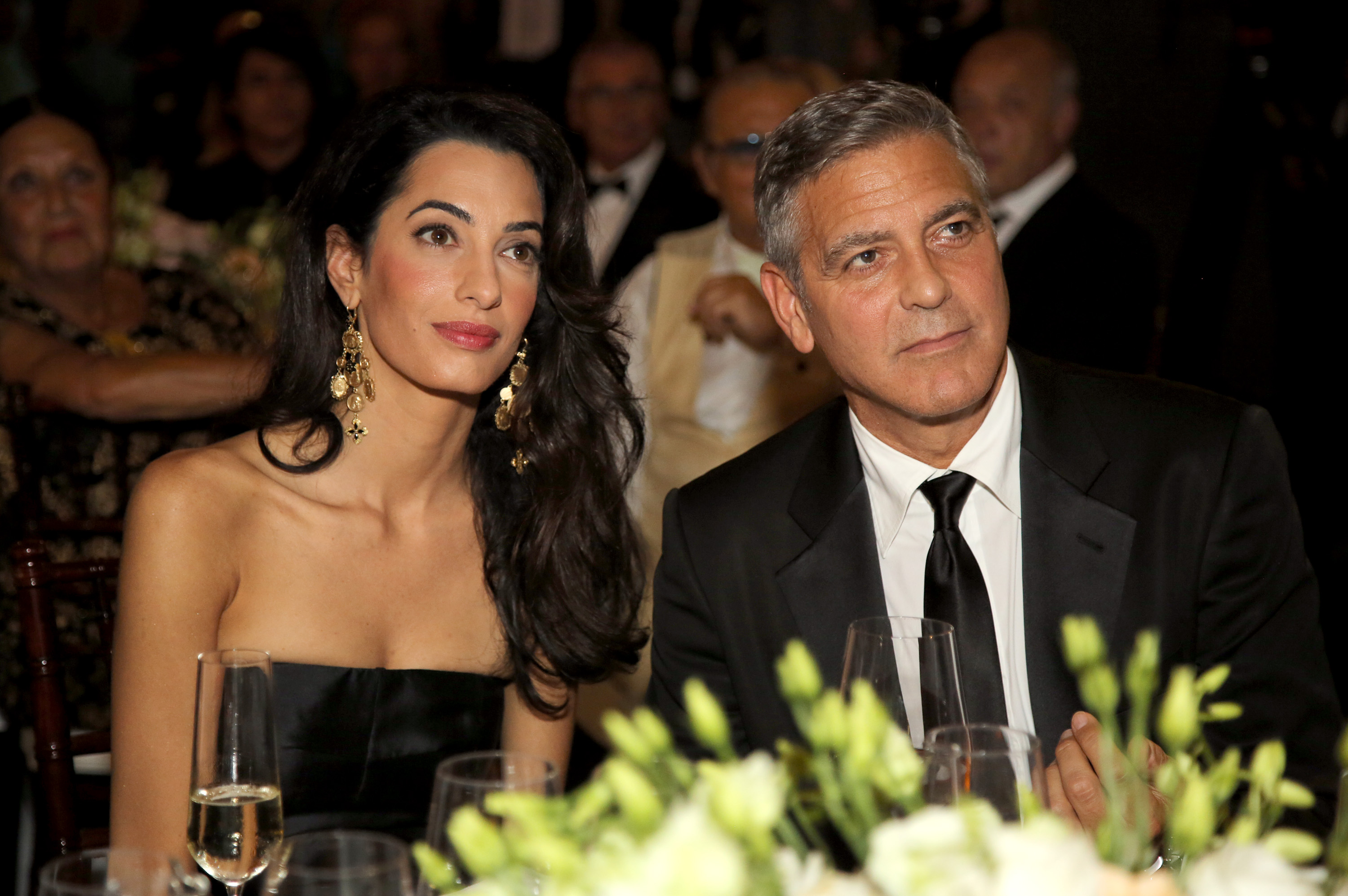 FLORENCE, ITALY - SEPTEMBER 07:  George Clooney (R) and Amal Alamuddin attend the Celebrity Fight Night gala celebrating Cele