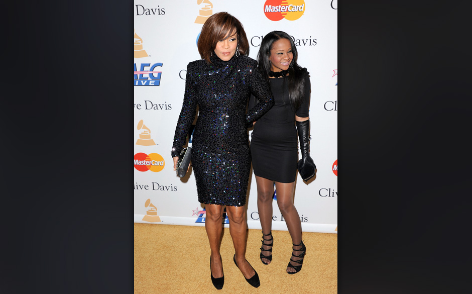 BEVERLY HILLS, CA - FEBRUARY 12:  Singer Whitney Houston and Bobbi Kristina Brown arrive at the 2011 Pre-GRAMMY Gala and Salu
