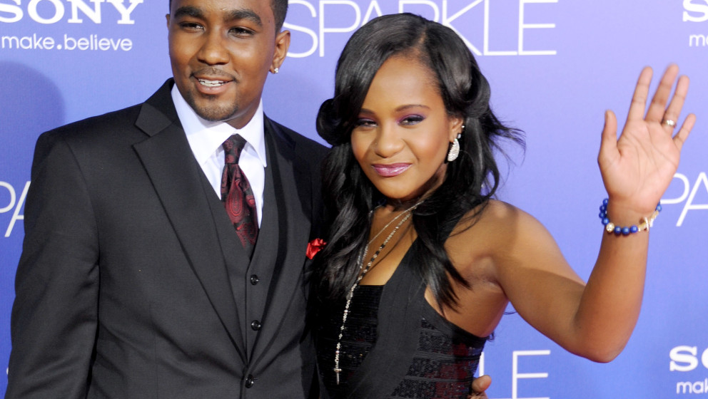 HOLLYWOOD, CA - AUGUST 16:  Bobbi Kristina Brown (R) and Nick Gordon arrive at the Los Angeles premiere of 'Sparkle' at Graum