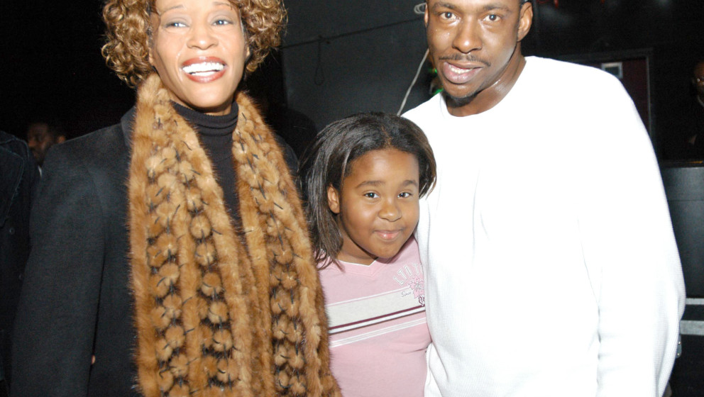 Whitney Houston, daughter Kristina and Bobby Brown  (Photo by Frank Mullen/WireImage)