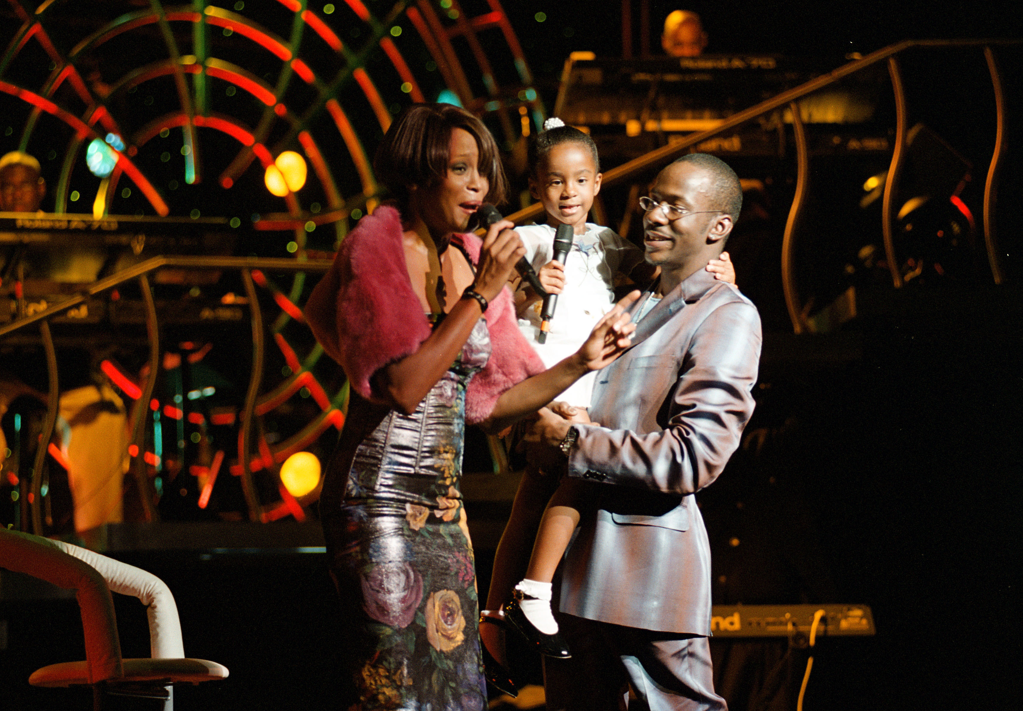 NEW YORK , NY - JULY 16: (L-R) Whitney Houston with her daughter Bobbi Kristina Brown and husband Bobbi Brown onstage during