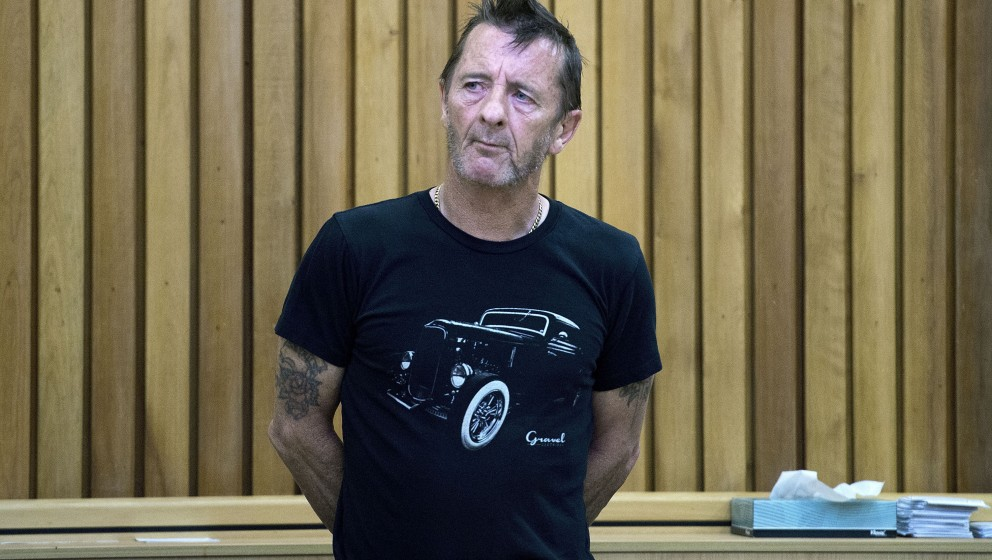 Former AC/DC drummer Phil Rudd stands in the dock as faces charges at the High Court in Tauranga, New Zealand on November 26,
