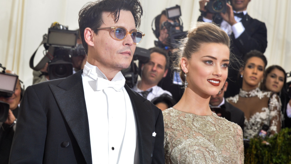 NEW YORK, NY - MAY 05:  Johnny Depp and Amber Heard attend the 'Charles James: Beyond Fashion' Costume Institute Gala at the