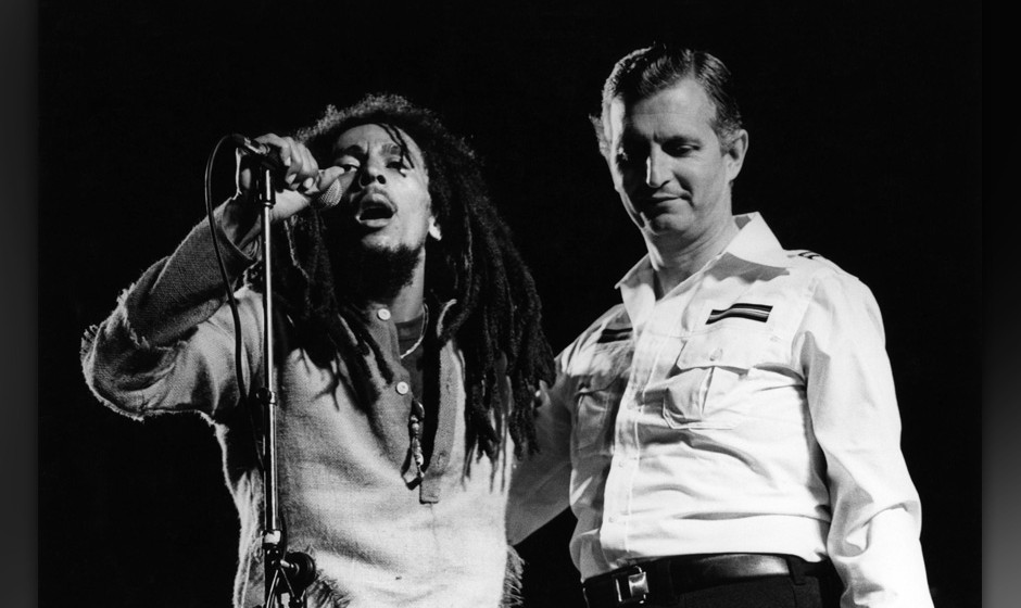 JAMAICA - APRIL 22:  Photo of Edward SEAGA and WAILERS and Bob MARLEY; L-R: Bob Marley, Edward Seaga (Prime Minister of Jamai