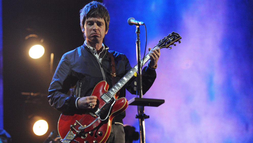 LONDON, ENGLAND - MARCH 06:  Noel Gallagher performs onstage for 'Give It Up For Comic Relief' at Wembley Arena on March 6, 2