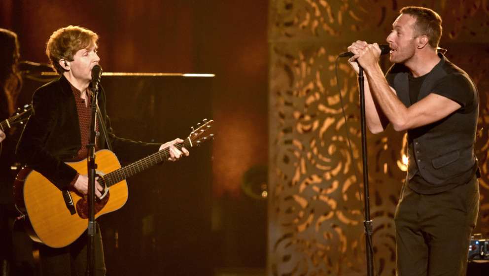 LOS ANGELES, CA - FEBRUARY 08:  Recording artists Beck (L) and Chris Martin perform onstage during The 57th Annual GRAMMY Awa