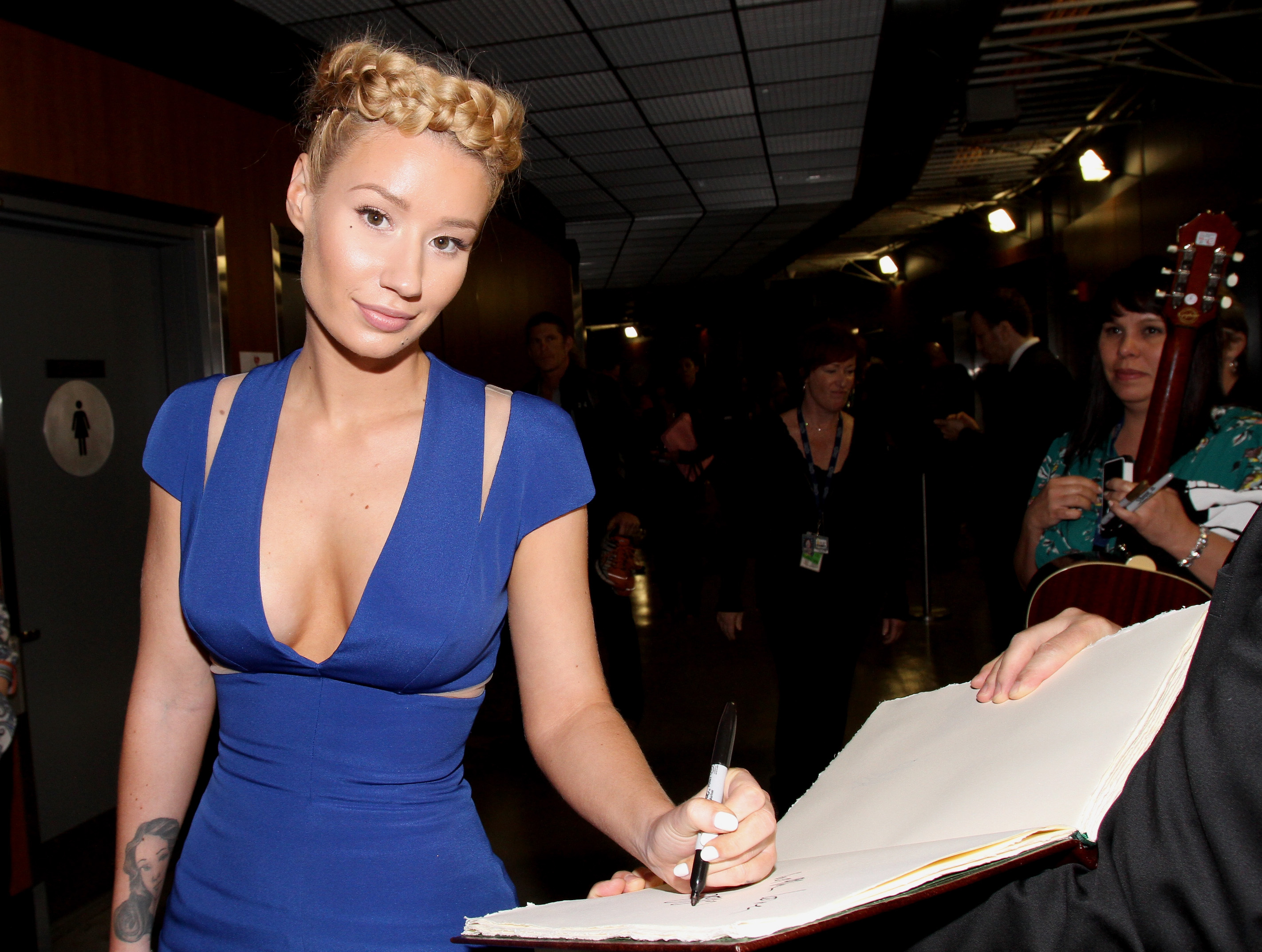 LOS ANGELES, CA - FEBRUARY 08:  Rapper Iggy Azalea poses backstage at the GRAMMY Charities Signings during The 57th Annual GR