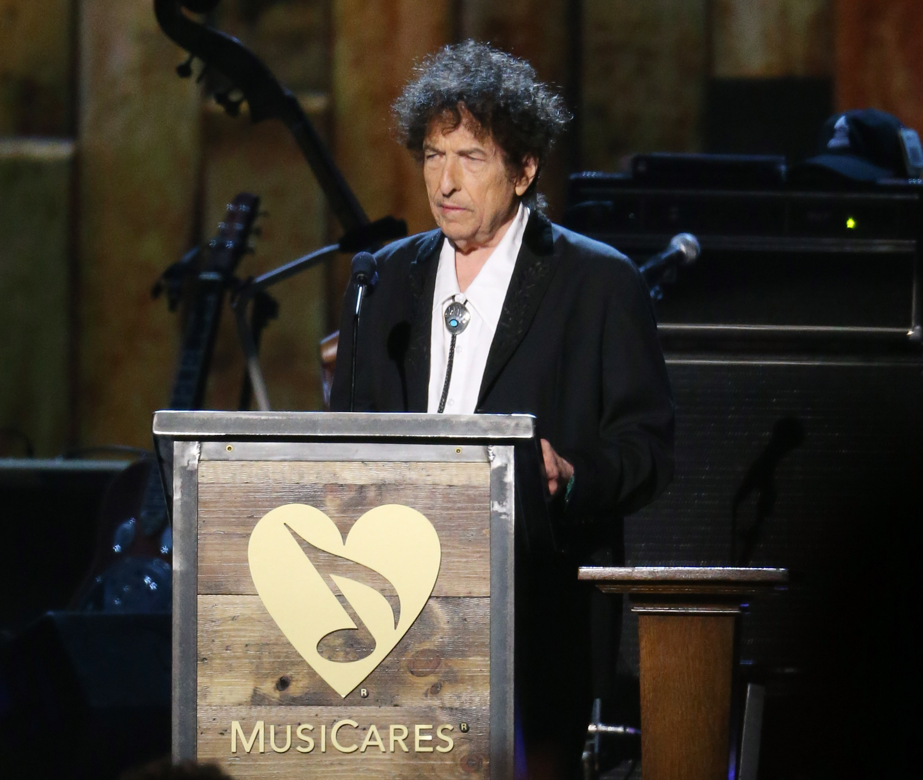 LOS ANGELES, CA - FEBRUARY 06:  Bob Dylan speaks onstage during the 2015 MusiCares Person of The Year honoring him held at Lo