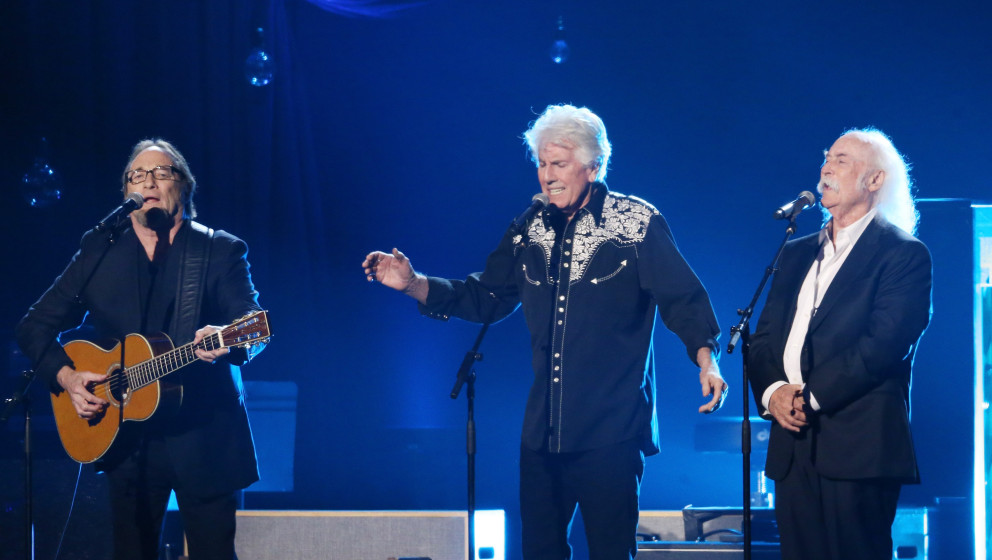 LOS ANGELES, CA - FEBRUARY 06:  Stephen Stills, Graham Nash and David Crosby perform onstage during the 2015 MusiCares Person