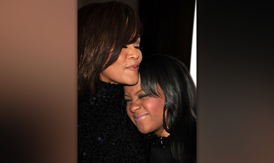 Singer Whitney Houston (L) and her daughter Bobbi Kristina arrive at the 2011 Pre-GRAMMY Gala and Salute To Industry Icons Ho