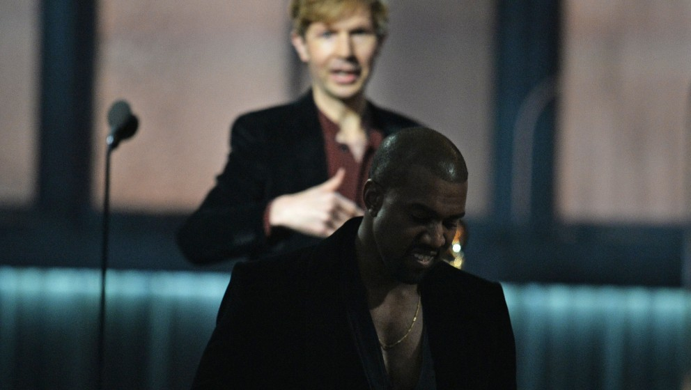 Winner for Album Of The Year Beck (L) reacts as Kanye West leaves the stage at the 57th Annual Grammy Awards in Los Angeles F