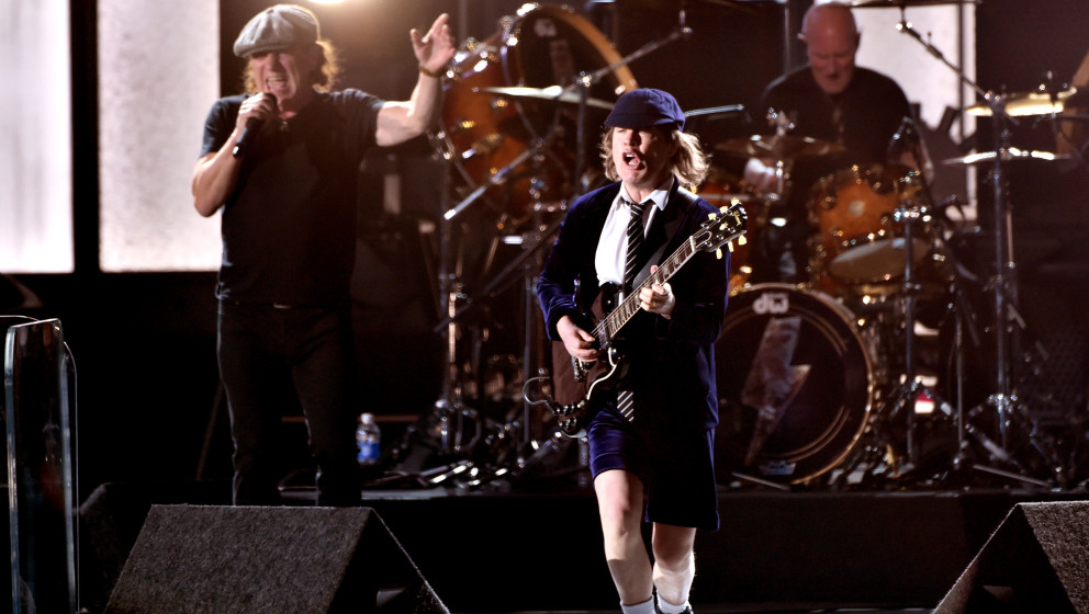 LOS ANGELES, CA - FEBRUARY 08:  (L-R) Musicians Brian Johnson, Angus Young and Chris Slade perform onstage during The 57th An