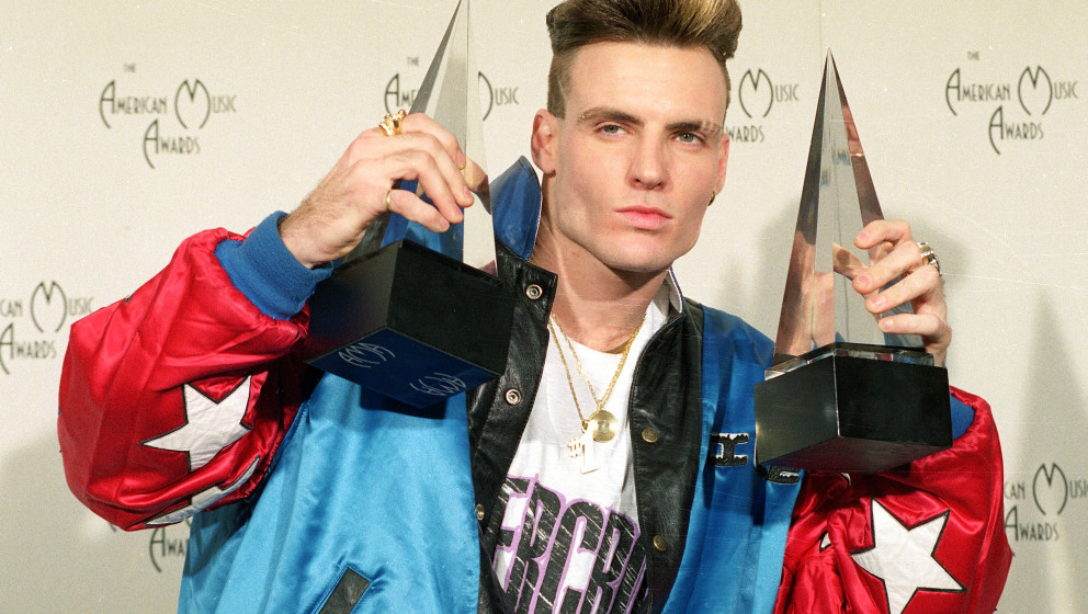 Vanilla Ice displays his awards he won in the rock and rap catagories at the American Music Awards in Los Angeles, Calif., on