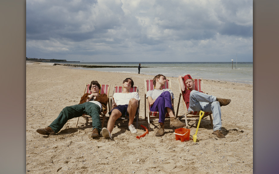English alternative rock band Blur relax on a beach, circa 1995. From left to right, Graham Coxon, Alex James, Damon Albarn a