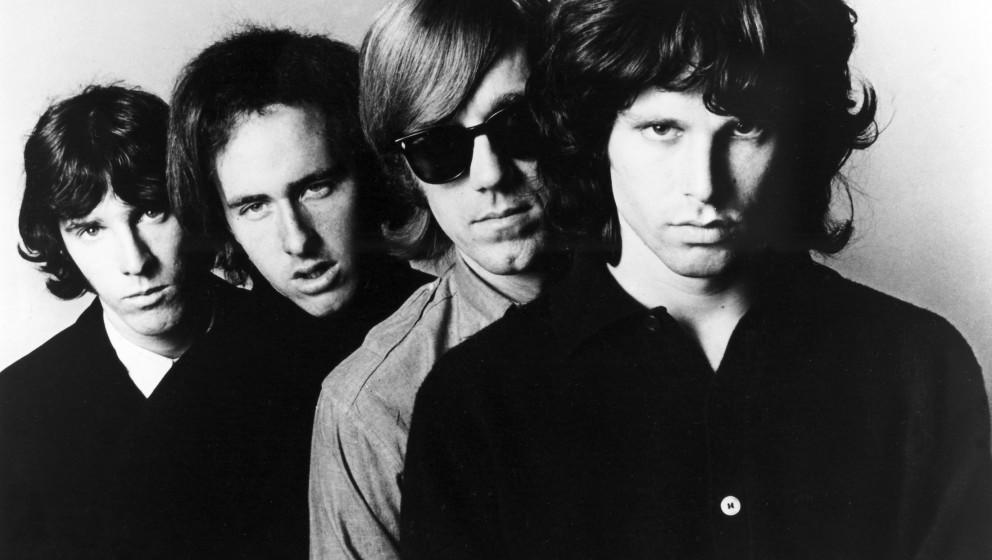THE DOORS [1965 -1972]  American Rock Group  [L-R] Drummer JOHN DENSMORE,  Guitarist ROBBY KRIEGER,  Keyboardist RAY MANZAREK