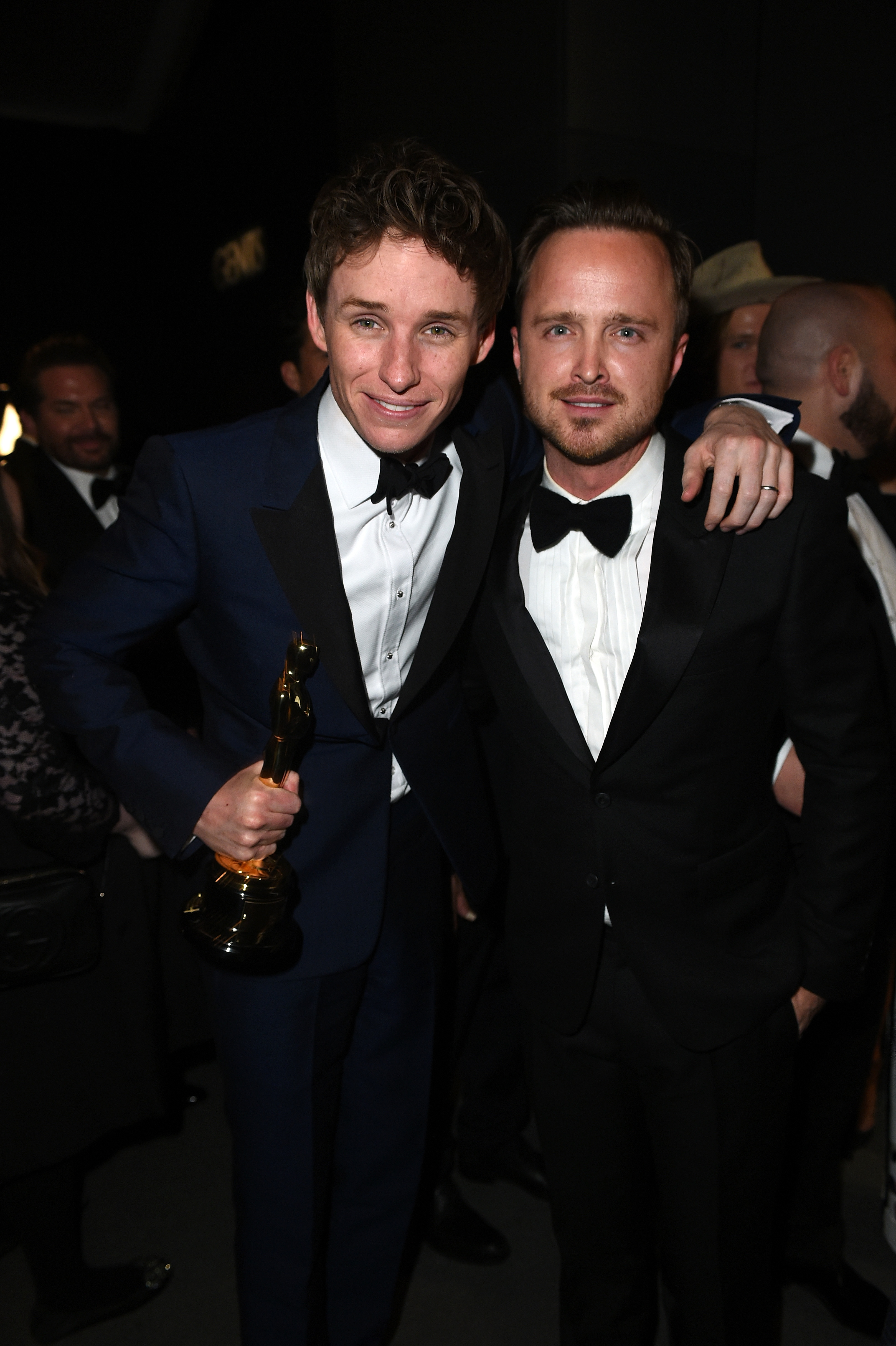 BEVERLY HILLS, CA - FEBRUARY 22:  (EXCLUSIVE ACCESS, SPECIAL RATES APPLY) Actors Eddie Redmayne (L) and Aaron Paul attend the