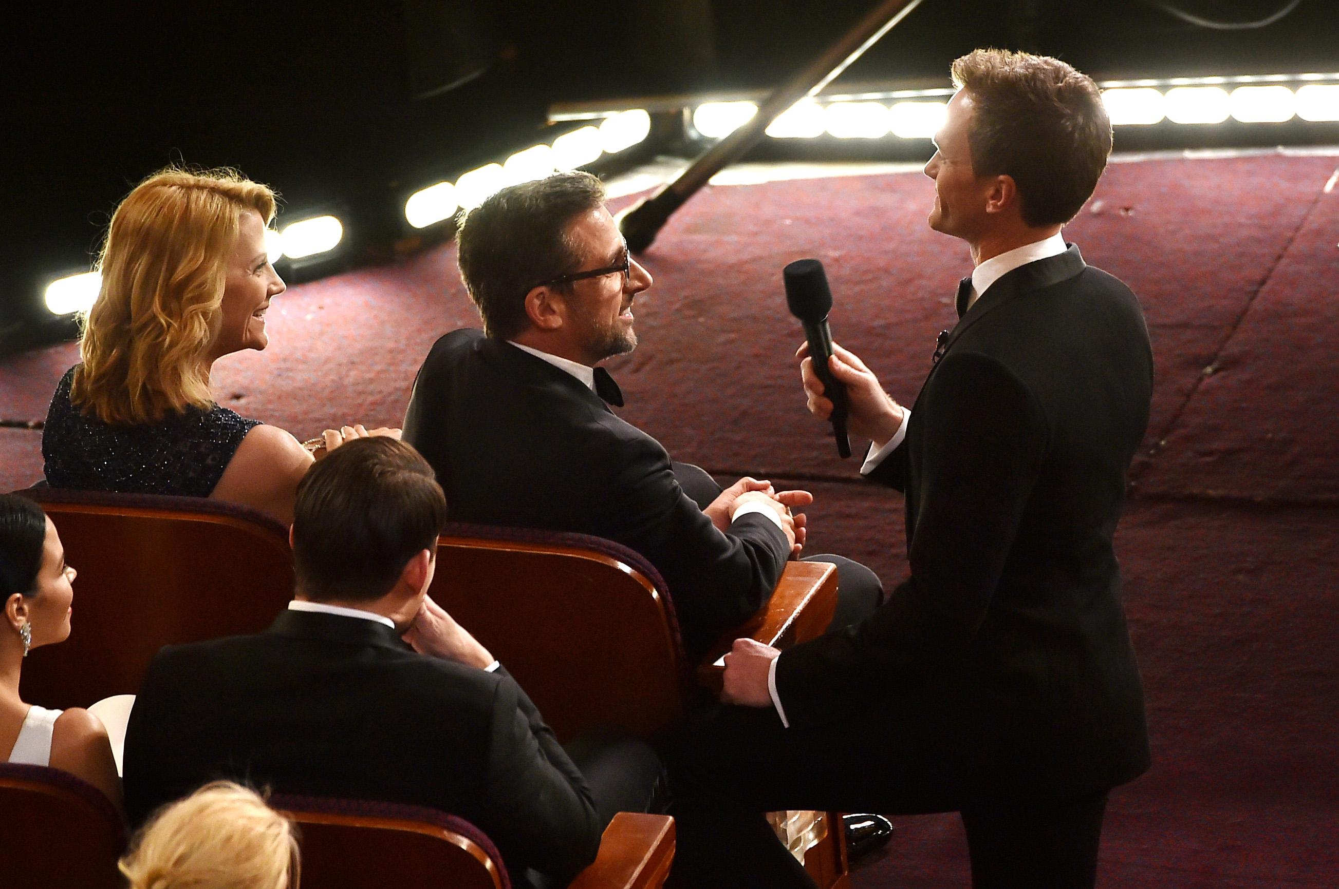 HOLLYWOOD, CA - FEBRUARY 22:  Host Neil Patrick Harris (R) talks with actor Steve Carell during the 87th Annual Academy Award