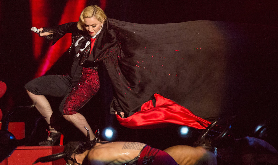 LONDON, ENGLAND - FEBRUARY 25:  Madonna falls as she performs on stage for the BRIT Awards 2015 at The O2 Arena on February 2