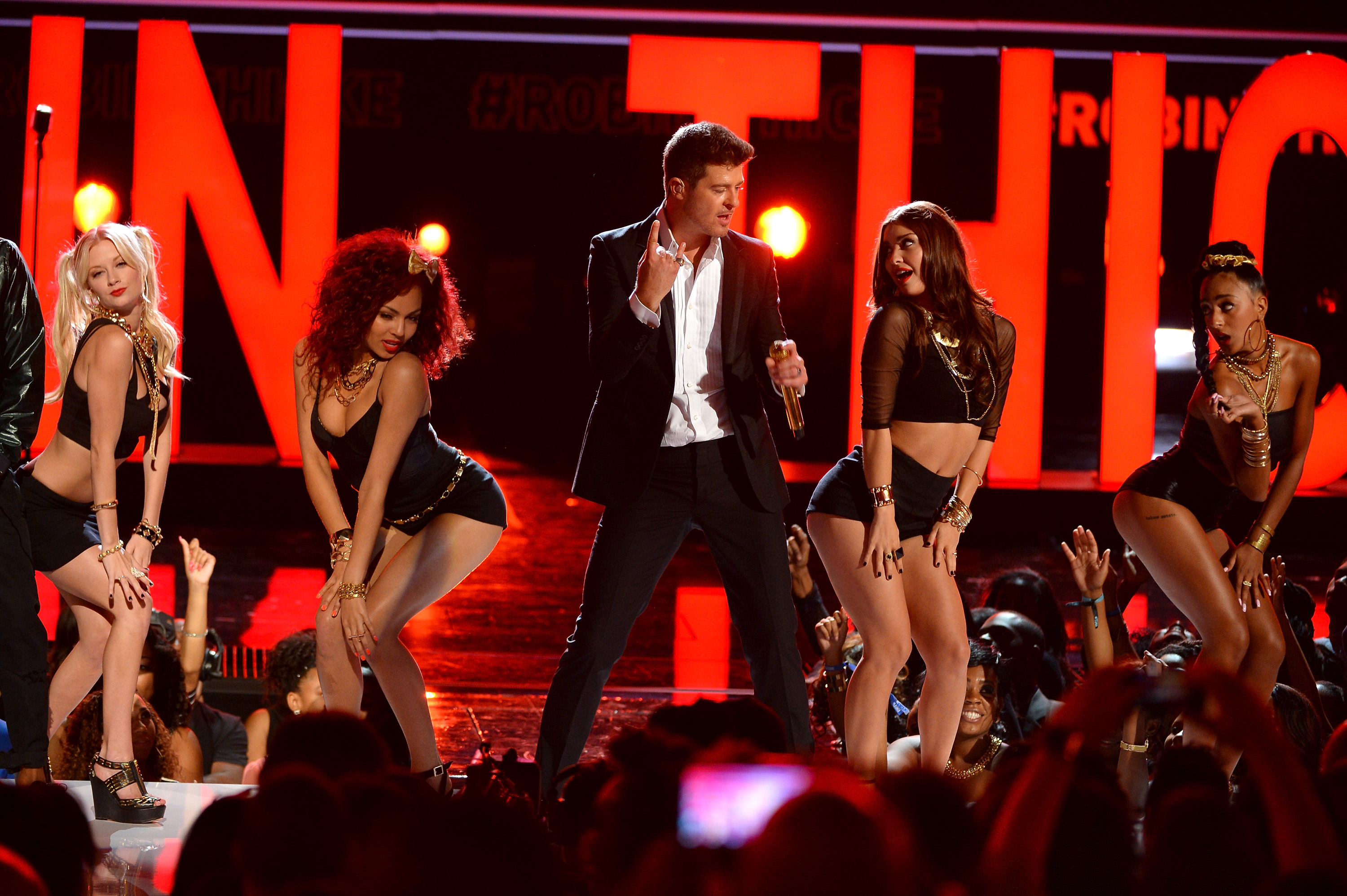 LOS ANGELES, CA - JUNE 30: Recording artist Robin Thicke performs onstage during the 2013 BET Awards at Nokia Theatre L.A. Li