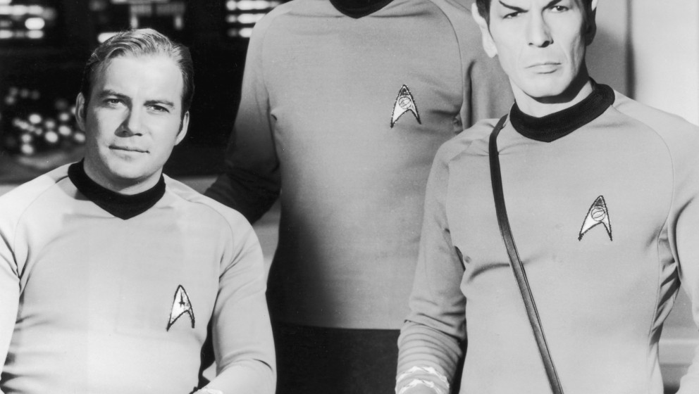 circa 1966:  From left to right, Canadian actor William Shatner as Captain Kirk, American actor DeForest Kelley (1920 - 1999)