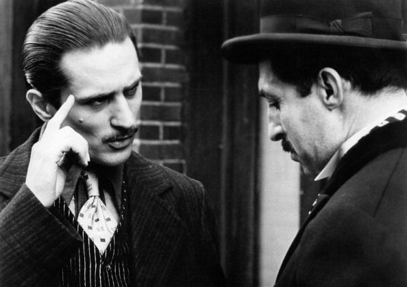 American actor Robert De Niro (left) and Italian actor Leopoldo Trieste (right) in a scene from the movie The Godfather, Part