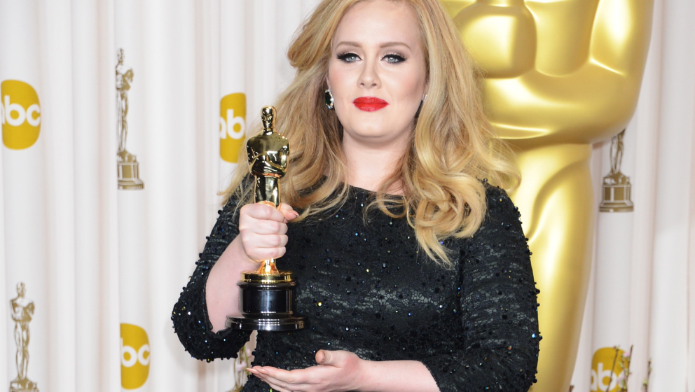 HOLLYWOOD, CA - FEBRUARY 24:  Singer Adele poses in the press room during the Oscars at Loews Hollywood Hotel on February 24,