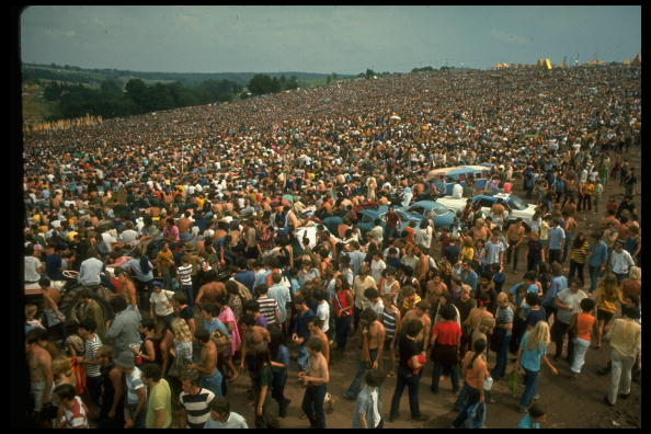NEW YORK, UNITED STATES - AUGUST 1969:  Overall of the huge crowd, looking towards large yellow tents, during the Woodstock M