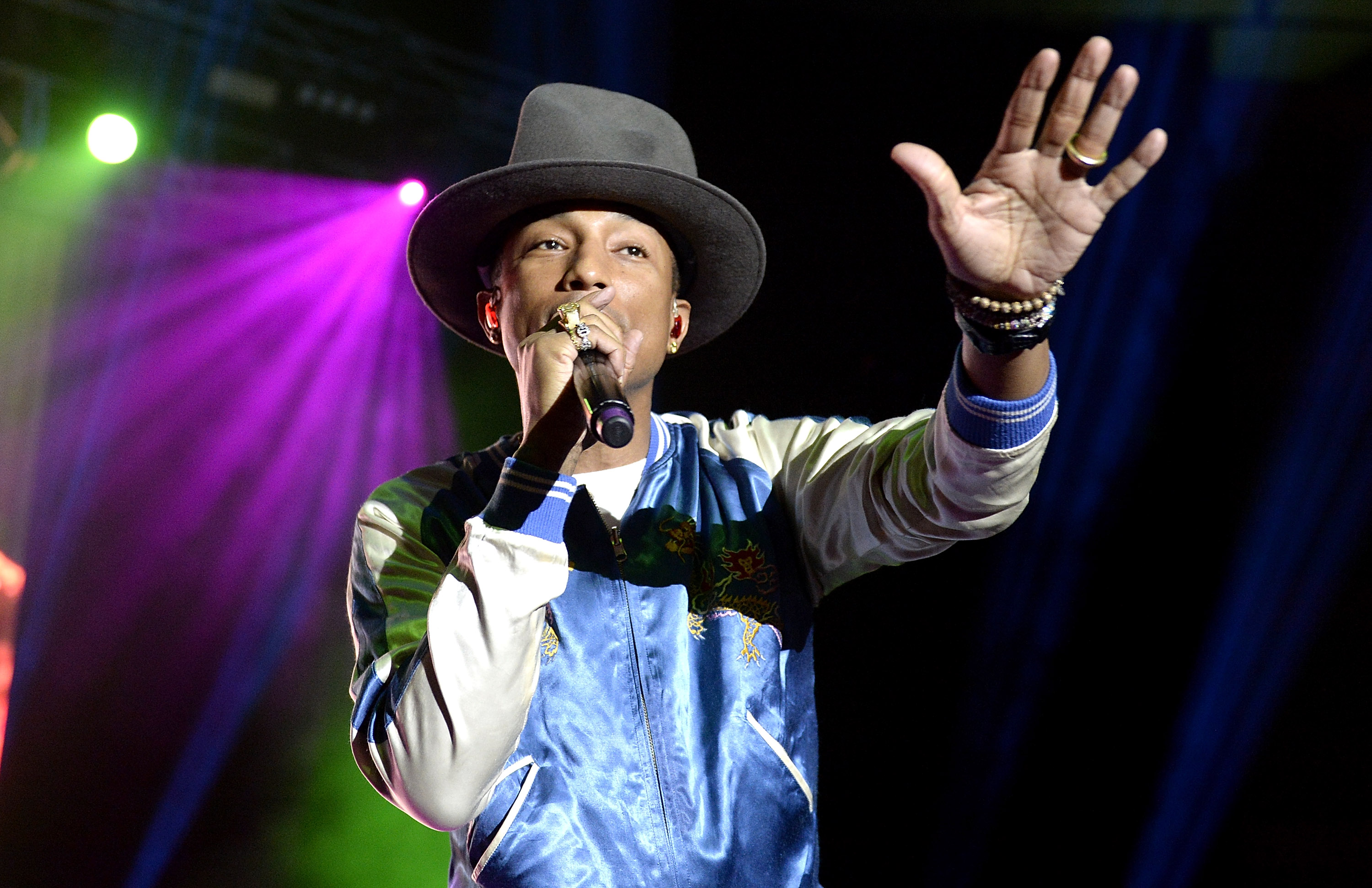 BRISBANE, AUSTRALIA - MARCH 12:  Pharrell performs live at The Riverstage on March 12, 2014 in Brisbane, Australia.  (Photo b