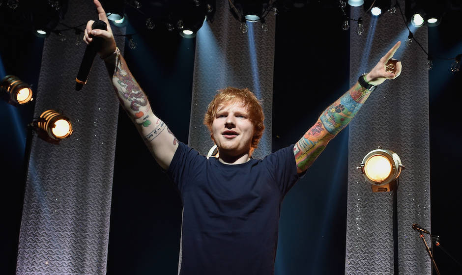 onstage during the iHeartRadio Album Release Party with Ed Sheeran hosted by Mario Lopez and presented by Pepsi at the iHeart