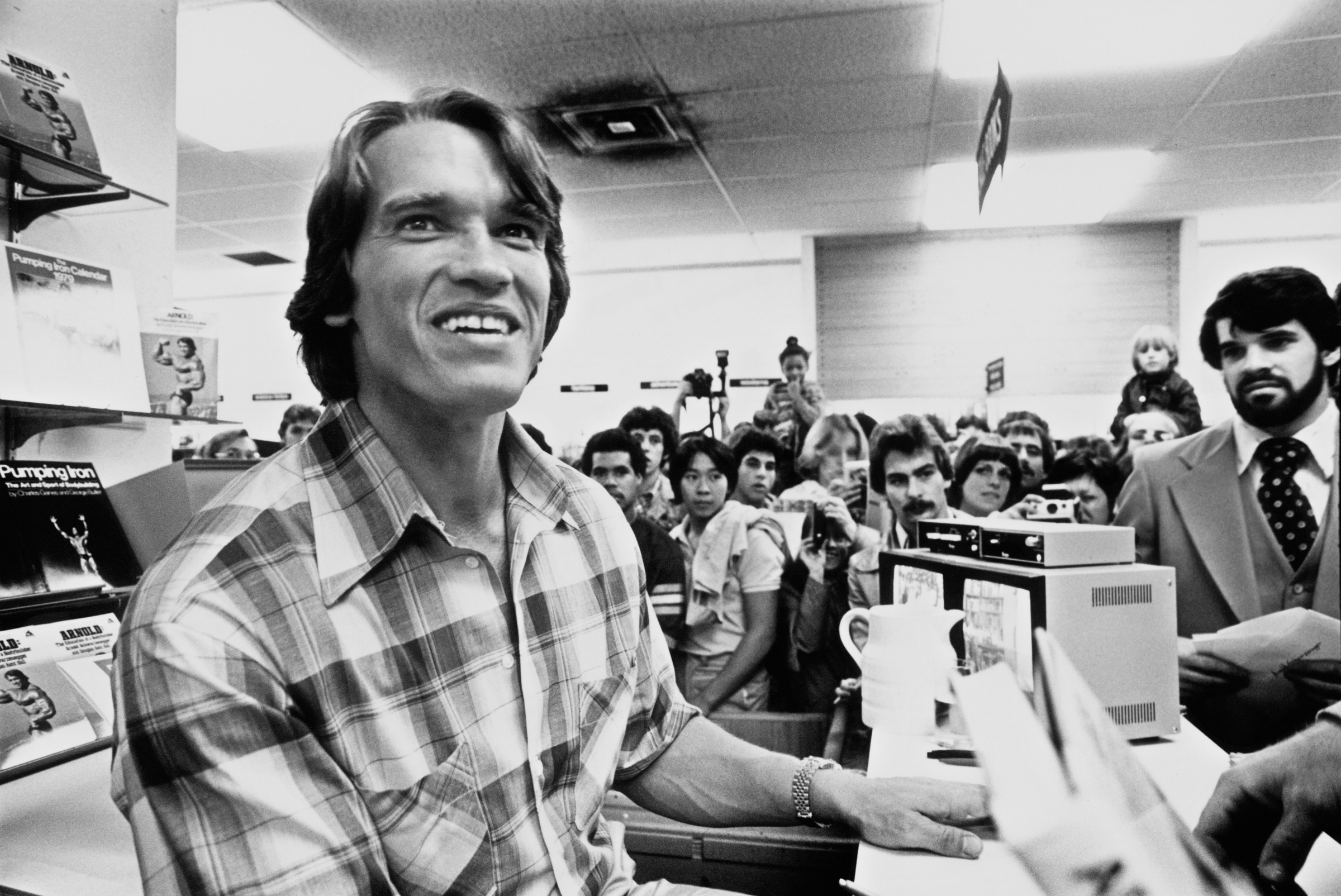 Arnold Schwarzenegger meets fans at a book signing for his autobiography/weight-training guide, 'Arnold: The Education of a B