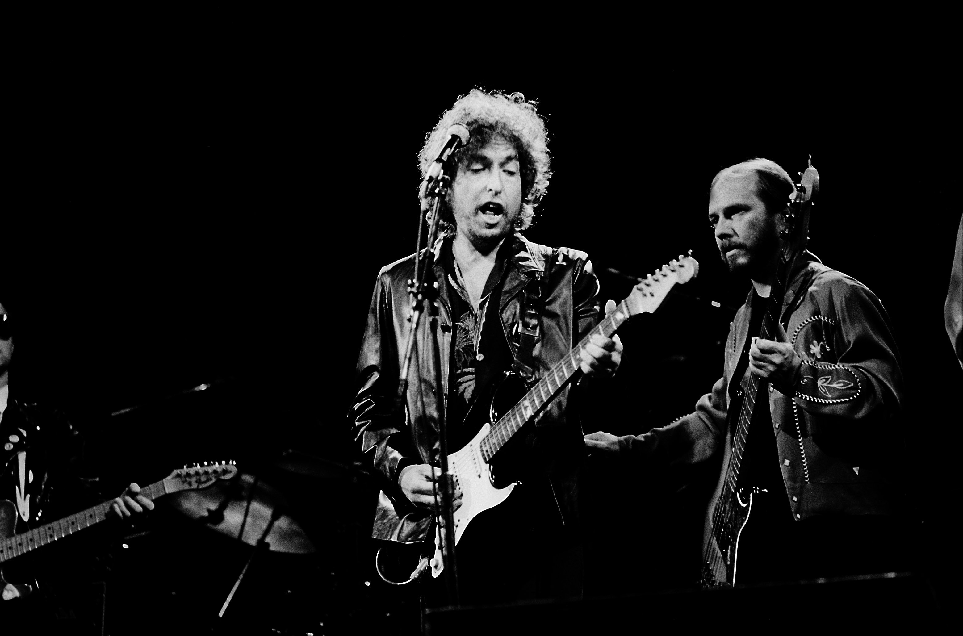 American musicians Bob Dylan (left) and Tim Drummond perform onstage at the Poplar Creek Music Theater in Hoffman Estates, Ch