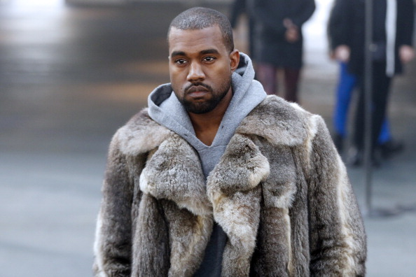 US musician Kanye West arrives to attend Givenchy's Fall/Winter 2014-2015 men's fashion show in Paris on January 17, 2014.