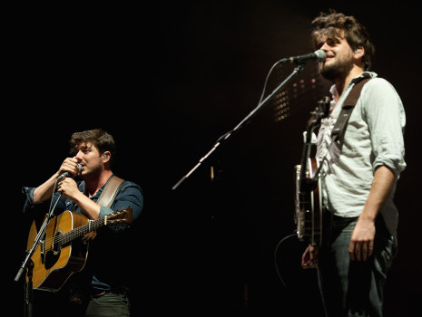KANSAS CITY, KS - SEPTEMBER 20:  Lead singer Marcus Mumford and banjo player Winston Marshall performing with Mumford & Sons at the Cricket Wireless Amphitheater on September 20, 2013 in Kansas City, Kansas.  (Photo by Fernando Leon/Getty Images)