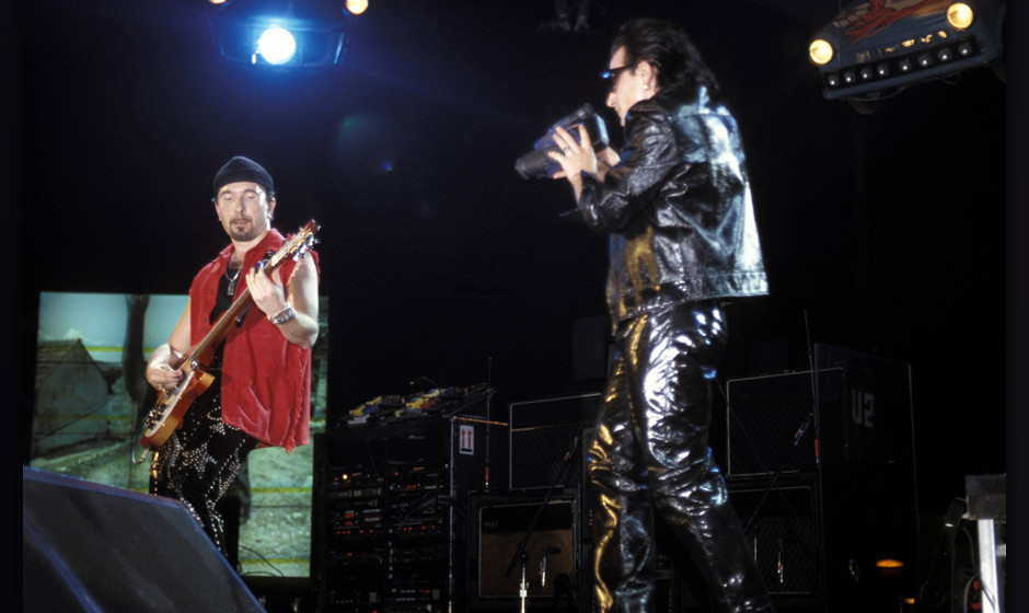 UNITED KINGDOM - MAY 31:  EARLS COURT  Photo of U2, The Edge and Bono (filming with camcorder) performing live onstage on Zoo